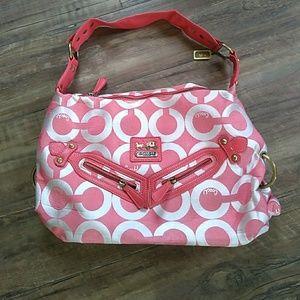 Melon colored Coach purse.